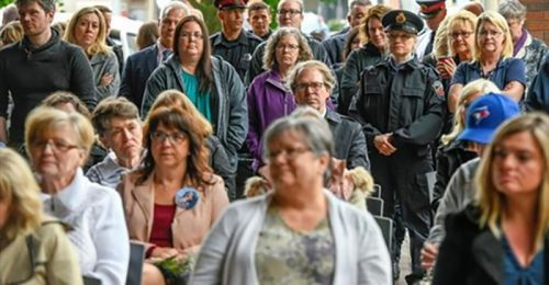 Photo: A gathering of victims of crime, support and community members and police staff listen to speakers. The 10th Annual memorial and BBQ for survivors and family of the victims of crime took place at Central Police Station.