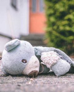 """Photo of a ripped teddy bear. This image is a link to the """"Signs of Abuse"""" page."""